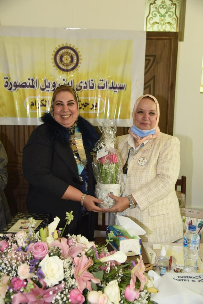 10-A bouquet of flowers presented from D95 Chairman to President of IWC of Tanta
