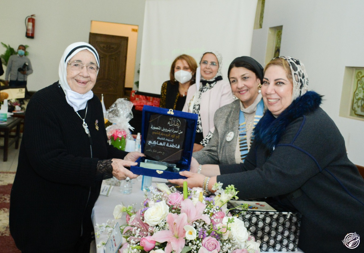11-A sheild of Appreciation & Gratitude to Mrs. Fatma El Hakee one of the Founder of IWC of Al Mansoura
