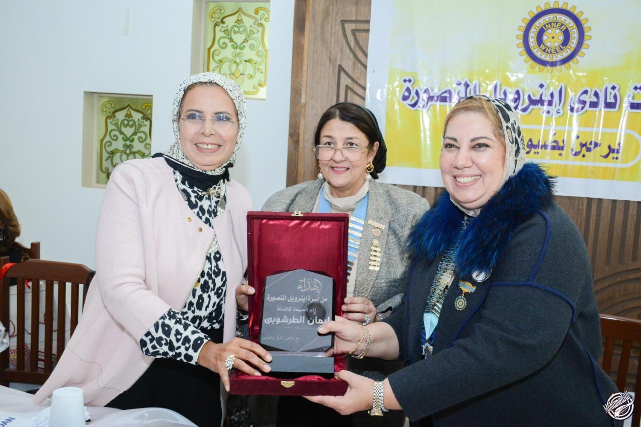 13-A shield of Appreciatrion From IWC of Al Mansoura to Mrs. Iman El Tarshoubi the Deputy Raporteur of Women Council in Dakahlia