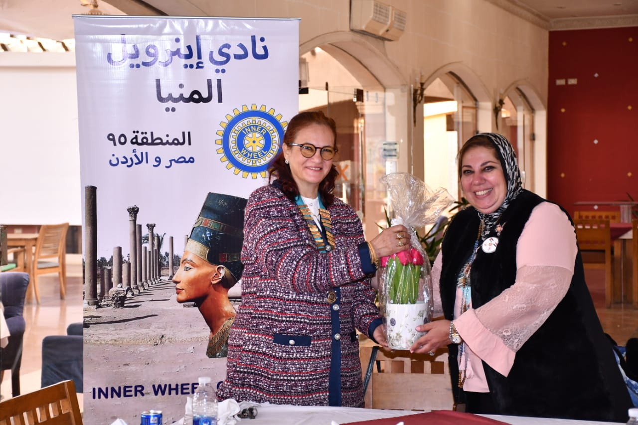11-D95 Chairman Presnted Flowers to Mrs. Hoda Fathi President of IWC of El Minya