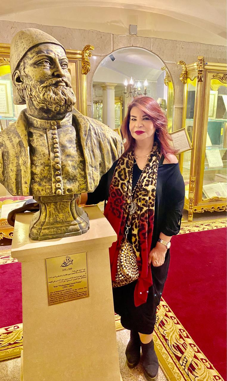 4- Mrs. Samia Abou El Fetouh President of IWC of Zamalek in front of the Statue of Muhammed Saeed