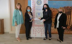 IWC of Amman Distributing food vouchers to Johd Center