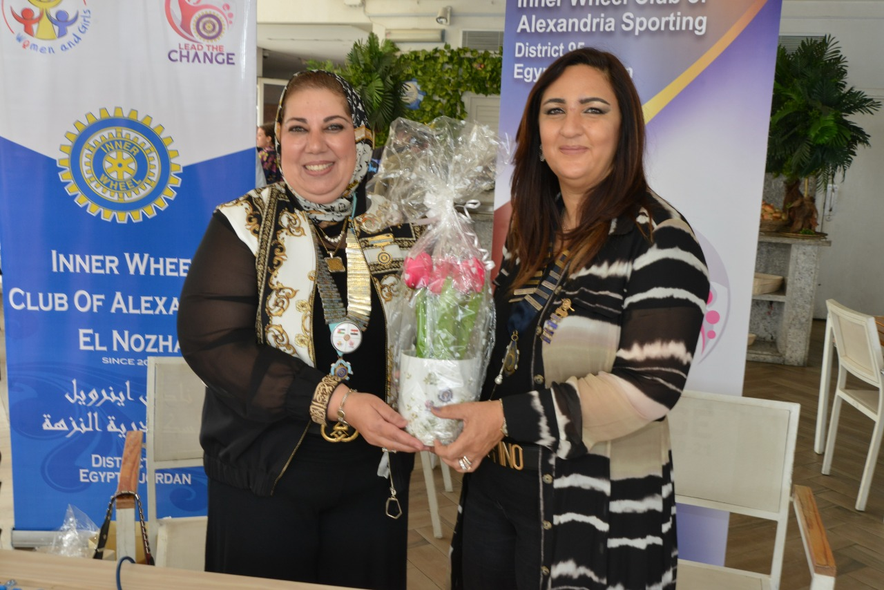 13-D95 Chairman Presenting a Bouquet of flowers to Mrs. Dina El Hadary President of IWC of Alexandria Sporting