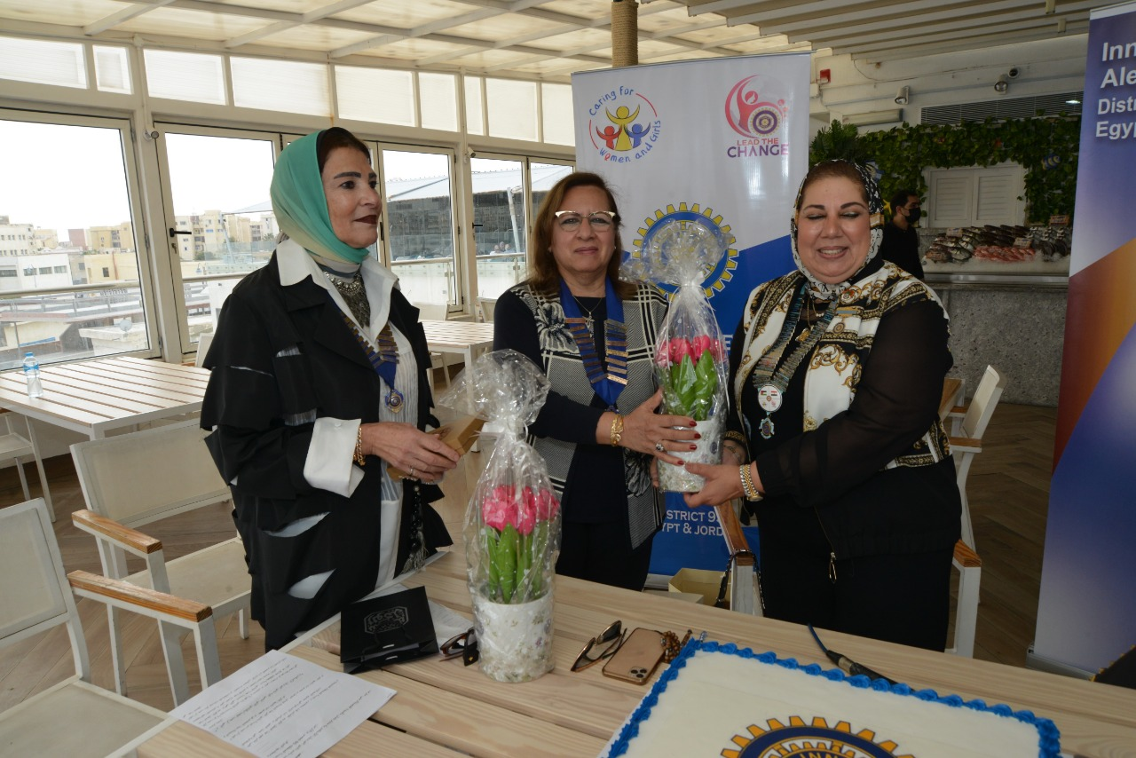 15- District Chairman Presenting flowers to President of IWC of Alexandria Mediterranean