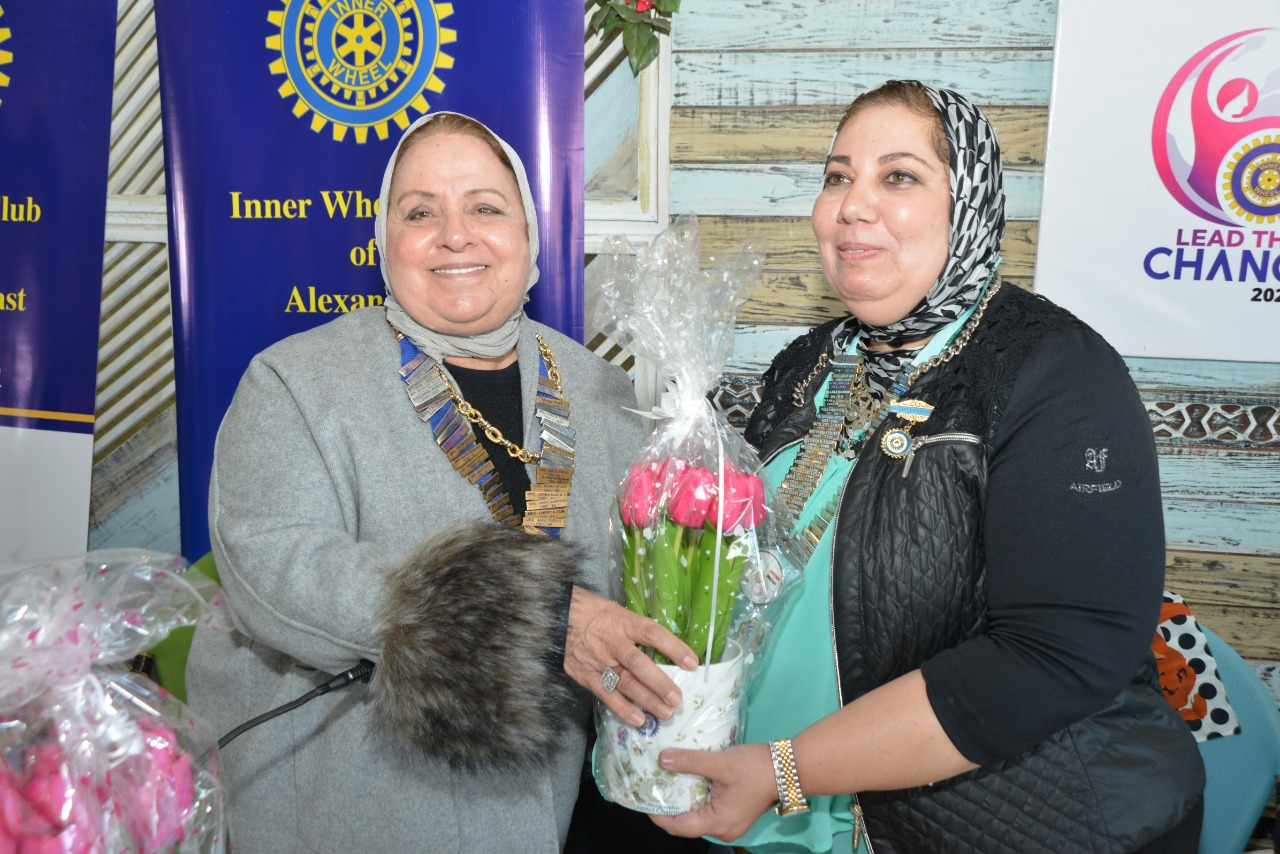 5-D95, Egypt& Jordan Chairman Presenting a bouquet of flowers to President of IWC of Alexandria East