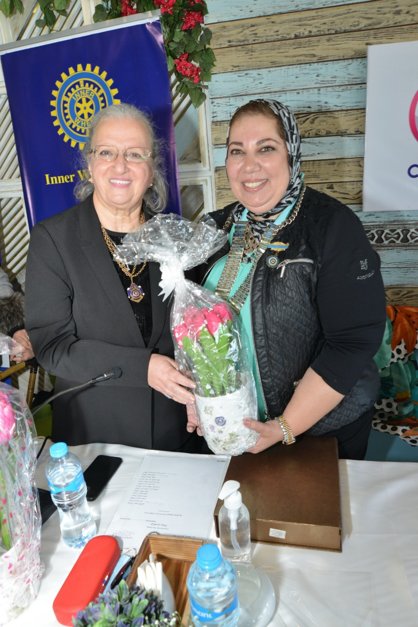 6-D95, Egypt& Jordan Chairman Presenting a bouquet of flowers to President of IWC of Damanhur
