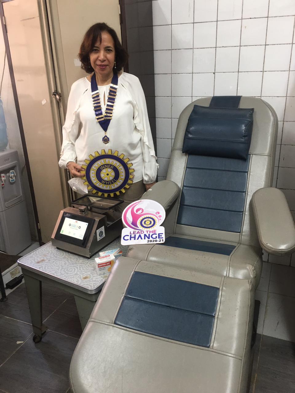 2-Mrs. Asrar El Bakri President of IWC of El Gezira & Donated Balance mixer & Sear