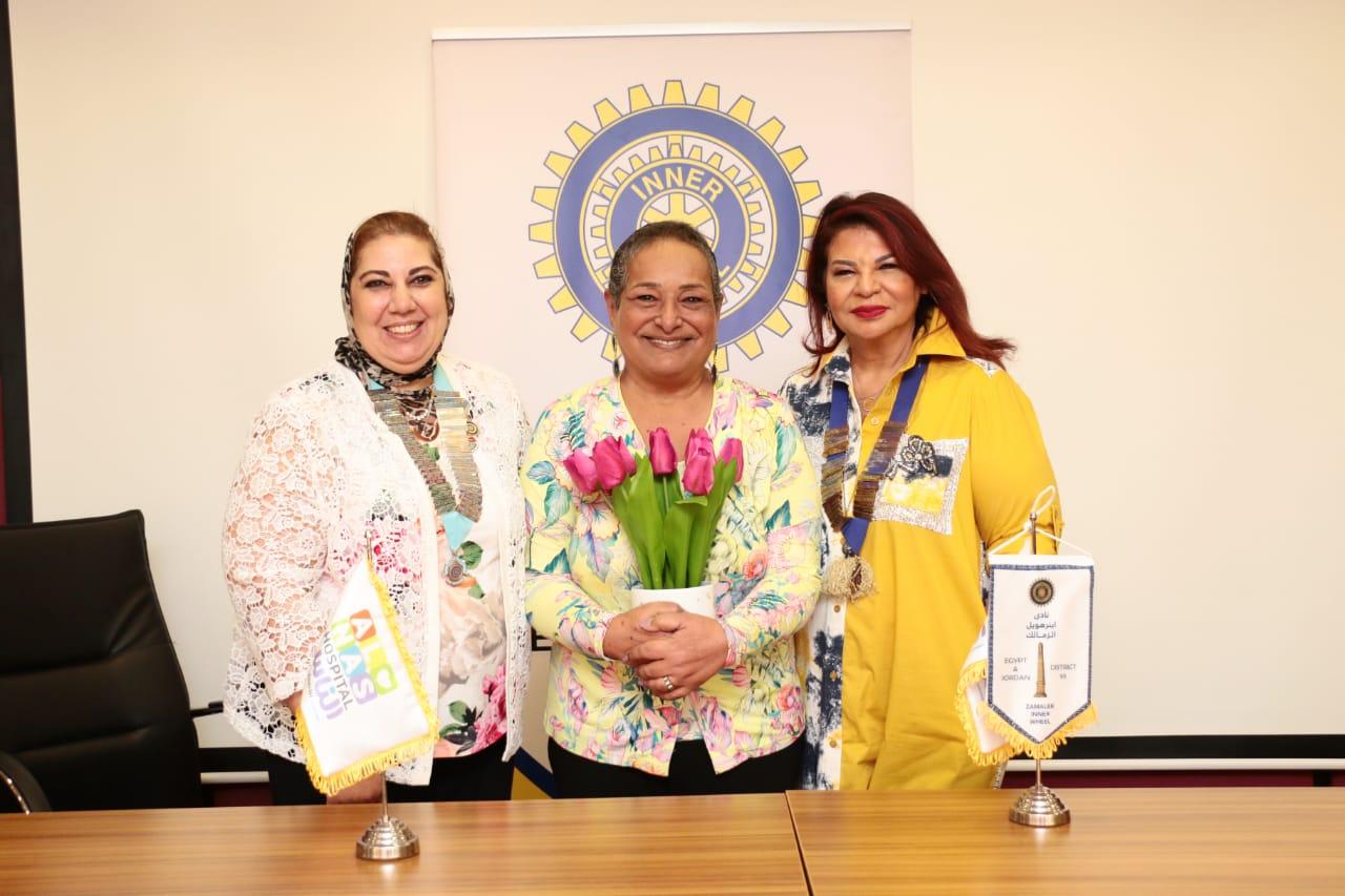 6- Mrs. Mona Aref D95Chairman Presented flowers to Mrs. Anisa Hassouna
