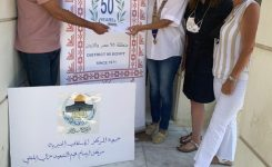 IWC of Amman delivered a Cheque to buy Eid new clothes to Mortar Azmi Al Mufti center for Orphans