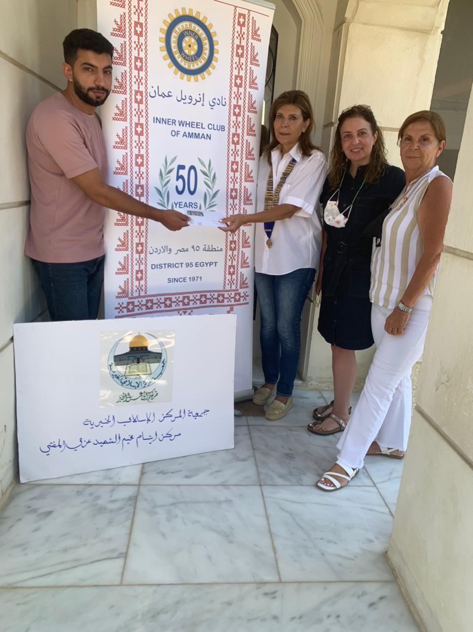 1-President of IWC of Amman delivered a Cheque to buy Eid new clothes to Mortar Azmi Al Mufti center for Orphans