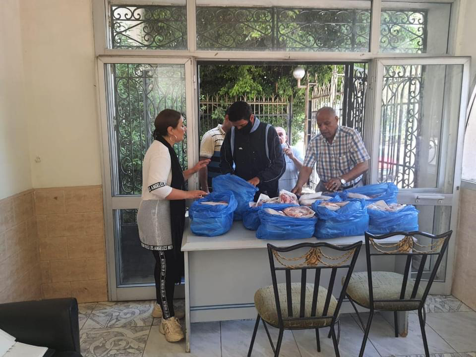 3- IWC of Alexandria Sporting in cooperation with Dr. Wael Sherif Bayoumi association distributing the charitable calf