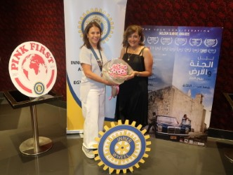 1-Lynne Farradj President of IWC of Petra offered bouquet of flowers to Najwa Najar director of the film