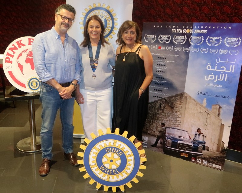 3-President of IWC of Petra with the director of the film &the producer Hani Al-Qurt